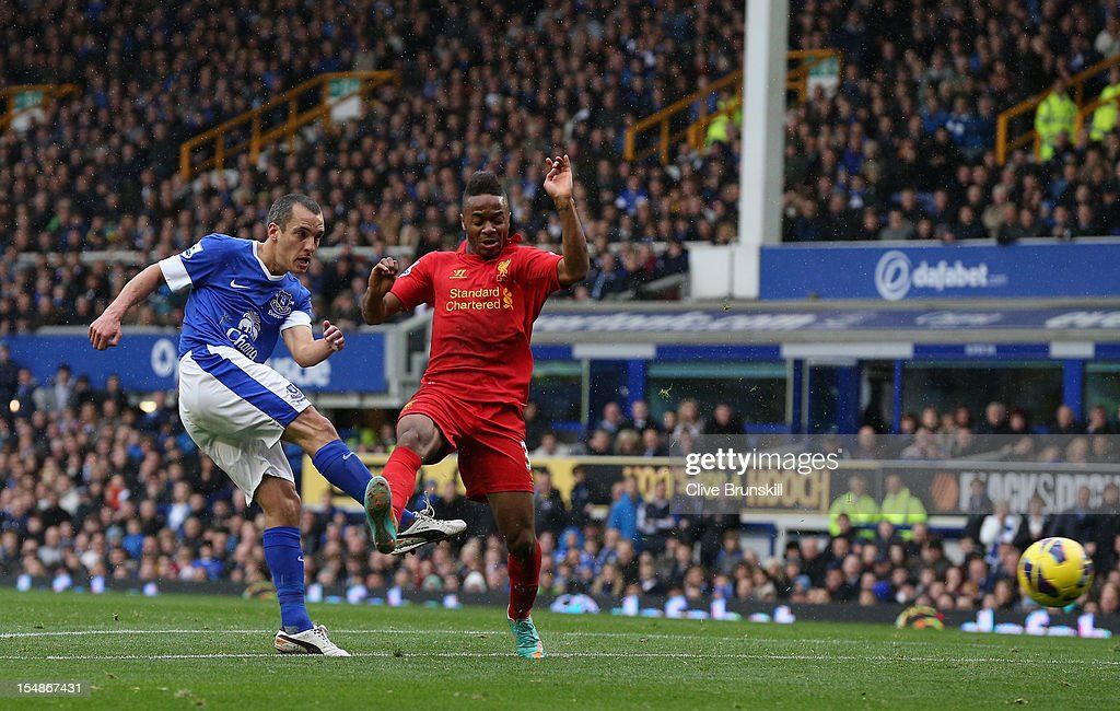 <a gi-track='captionPersonalityLinkClicked' href=/galleries/search?phrase=Leon+Osman&family=editorial&specificpeople=208939 ng-click='$event.stopPropagation()'>Leon Osman</a> of Everton scores his team's first goal during the Barclays Premier League match between Everton and Liverpool at Goodison Park on October 28, 2012 in Liverpool, England.