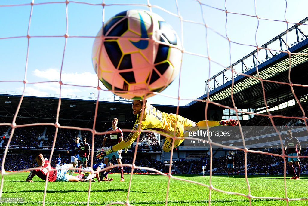 Leon Osman (2nd L) of Everton scores his team's first goal past Adrian of West Ham during the Barclays Premier League match between West Ham United and Everton at Boleyn Ground on May 16, 2015 in London, England.