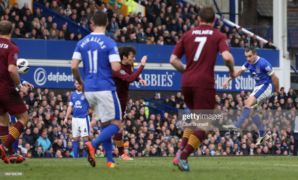 <a gi-track='captionPersonalityLinkClicked' href=/galleries/search?phrase=Leon+Osman&family=editorial&specificpeople=208939 ng-click='$event.stopPropagation()'>Leon Osman</a> of Everton scores the opening goal during the Barclays Premier League match between Everton and Manchester City at Goodison Park on March 16, 2013 in Liverpool, England.