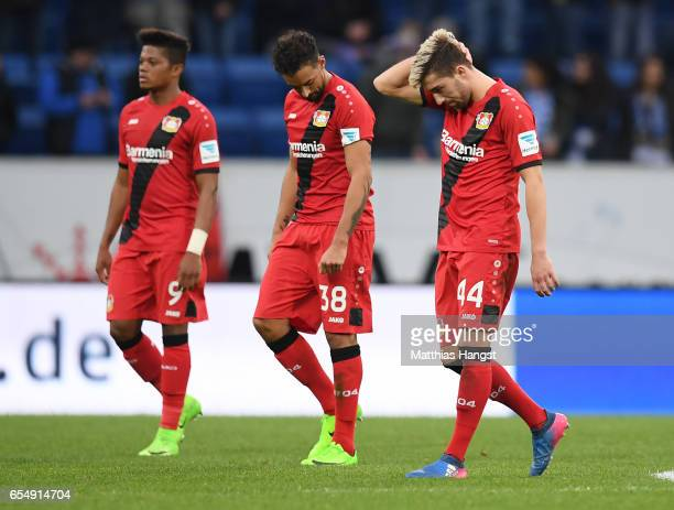 Leon Patrick Bailey of Leverkusen Karim Bellarabi of Leverkusen and Kevin Kampl of Leverkusen show their disappointment during the Bundesliga match...