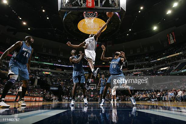 Leon Powe of the Memphis Grizzlies shoots over Wayne Ellington of the Minnesota Timberwolves on April 2 2011 at FedEx Forum in Memphis Tennessee NOTE...