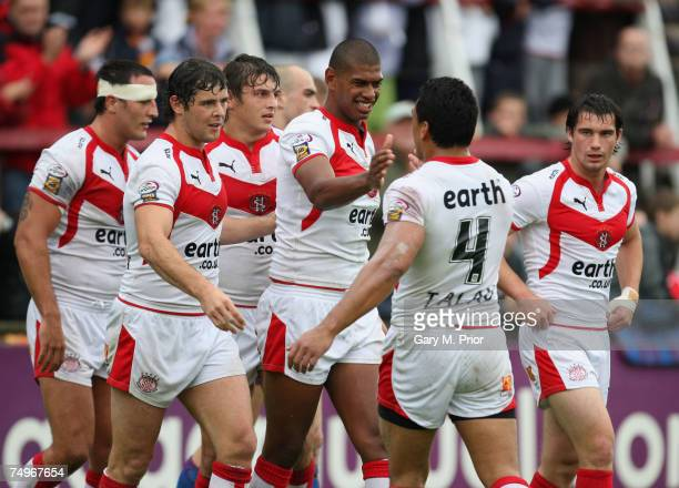 Leon Pryce of St Helens is congratulated by his team mates after scoring a try during the Engage Super League match between St Helens and...