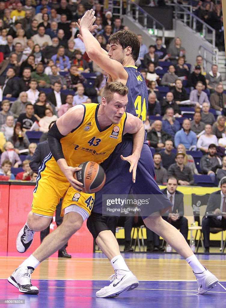Leon Radosevic, #43 of Alba Berlin competes with Ante Tomic, #44 of FC Barcelona during the Euroleague Basketball Top 16 Date 1 game between Alba Berlin v FC Barcelona at O2 World on January 2, 2015 in Berlin, Germany.