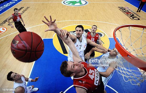Leon Radosevic #43 of Lietuvos Rytas Vilnius competes with Bostjan Nachbar #7 of Brose Baskets Bamberg during the 20122013 Turkish Airlines...