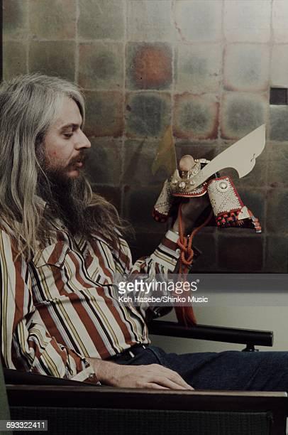 Leon Russell watching gift Kabuto helmet at a hotel Osaka November 1973