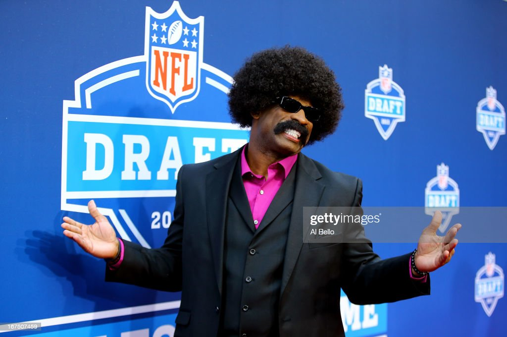 Leon Sandcastle of Primetime University arrives on the red carpet prior to the first round of the 2013 NFL Draft at Radio City Music Hall on April 25, 2013 in New York City. Sandcastle is actually a character being played by <a gi-track='captionPersonalityLinkClicked' href=/galleries/search?phrase=Deion+Sanders&family=editorial&specificpeople=202222 ng-click='$event.stopPropagation()'>Deion Sanders</a>.