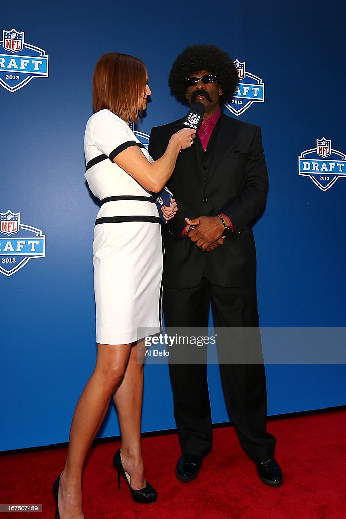 Leon Sandcastle of Primetime University is interviewed as he arrives on the red carpet prior to the first round of the 2013 NFL Draft at Radio City Music Hall on April 25, 2013 in New York City. Sandcastle is actually a character being played by Deion Sanders.