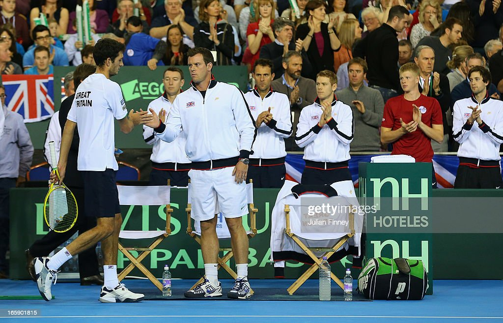 Leon Smith, Captain of Great Britain supports James Ward of Great Britain after he won the first set against Dmitry Tursunov of Russia during day three of the Davis Cup match between Great Britain and Russia at the Ricoh Arena on April 7, 2013 in Coventry, England.