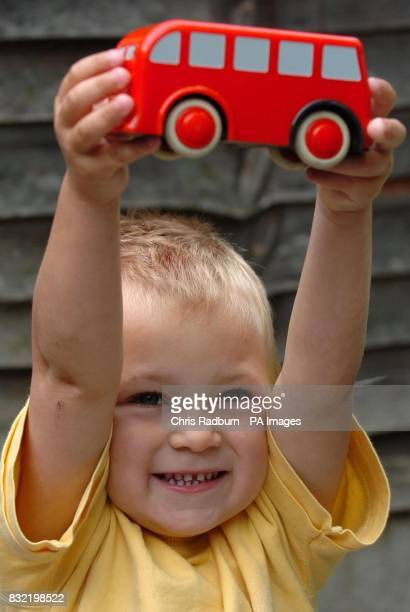 Leon Smith from Braintree Essex holds up a toy busafter being reunited with his mum at their home in Braintree PRESS ASSOCIATION Photo Picture date...
