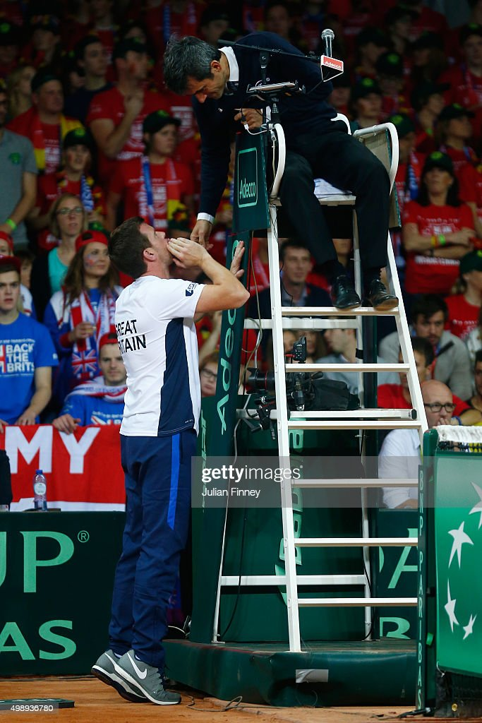Leon Smith the Captain of Great Britain speaks with the Umpire during the singles match between Ruben Bemelmens of Belgium and Andy Murray of Great...