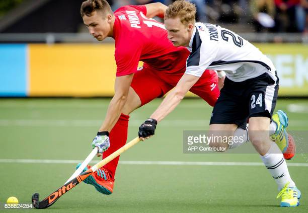 Leon Thornblom of Austria vies with Patrick Pawlak of Poland during the women's EuroHockey Championships match between Austria and Poland in...