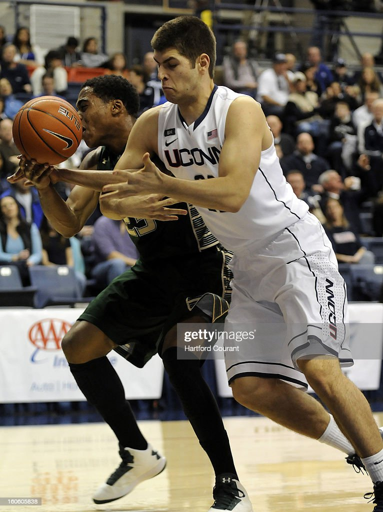 Leon Tolksdorf of Connecticut battles with Javontae Hawkins of the South Florida Bulls for a rebound during the first half at Gampel Pavilion in Storrs, Connecticut, Sunday, February 3, 2013.