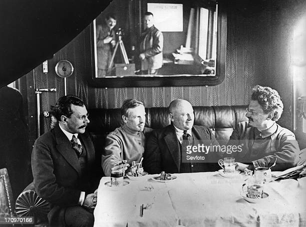 Leon trotsky entertains unidentified officials in his railway carriage office soviet union