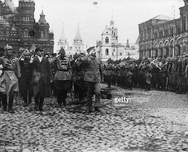 Leon trotsky people's commissar for military and naval affairs at a military parade in red square in honor of the third congress of the communist...