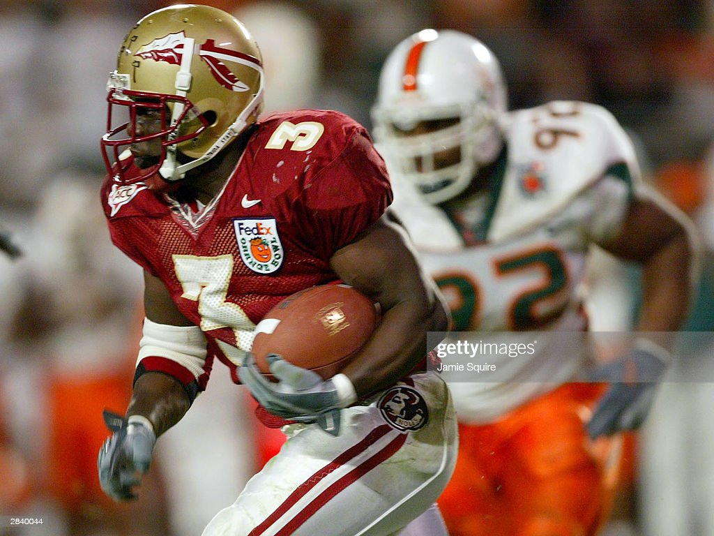 Leon Washington of the Florida State Seminoles carries the ball against the Miami Hurricanes during the Orange Bowl January 1 2004 at Pro Player...