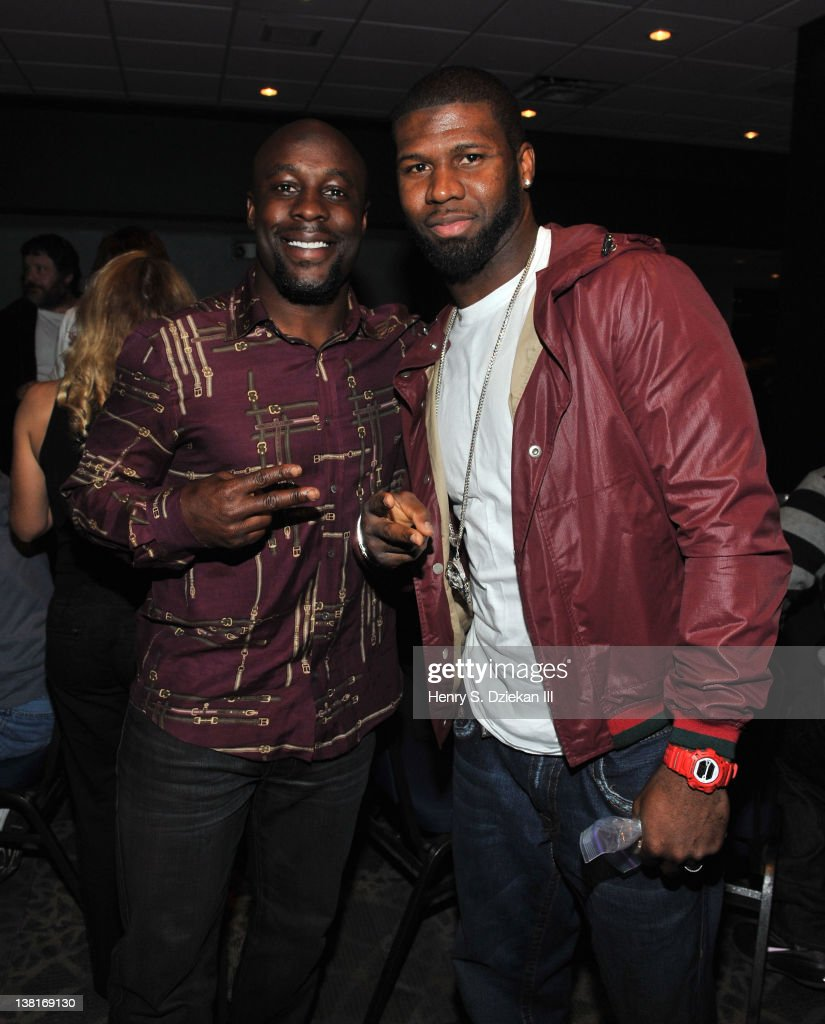 Leon Washington of the Seattle Seahawks and Devin Hester of the Chicago Bears attend the 2012 Celebrity Poker Tournament at the Indianapolis Zoo on...