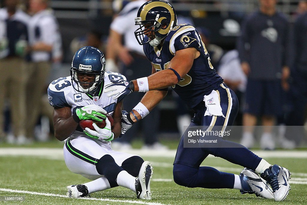 Leon Washington of the Seattle Seahawks fields a punt against Bryan Kehl of the St Louis Rams at the Edward Jones Dome on November 20 2011 in St...