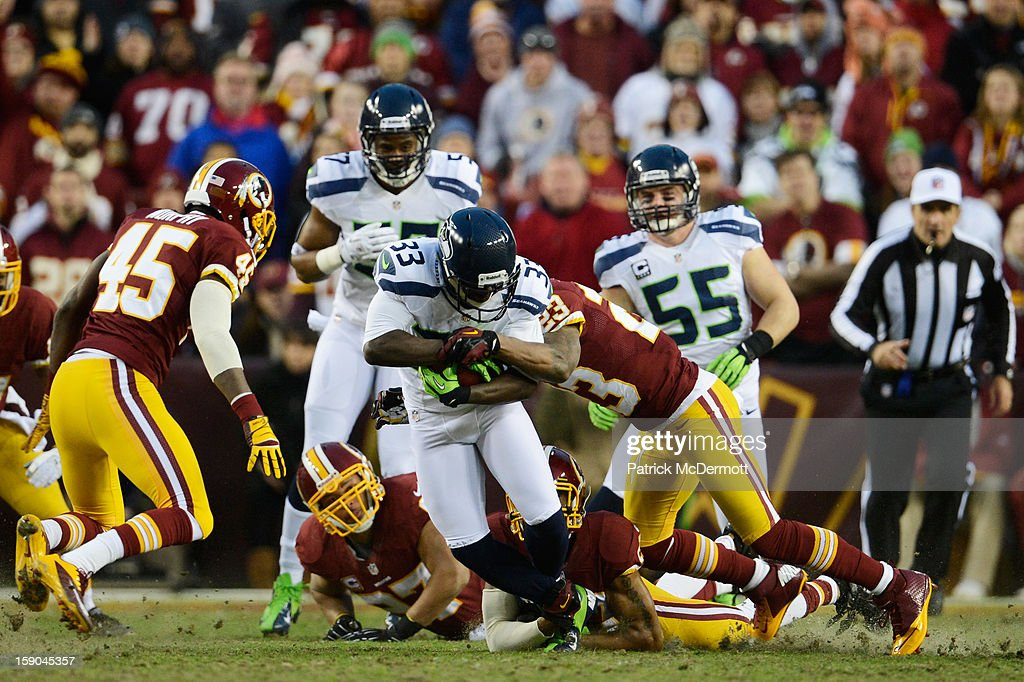 Leon Washington of the Seattle Seahawks returns the kickoff after the Washington Redskins scored the first touchdown of the game during the NFC Wild...