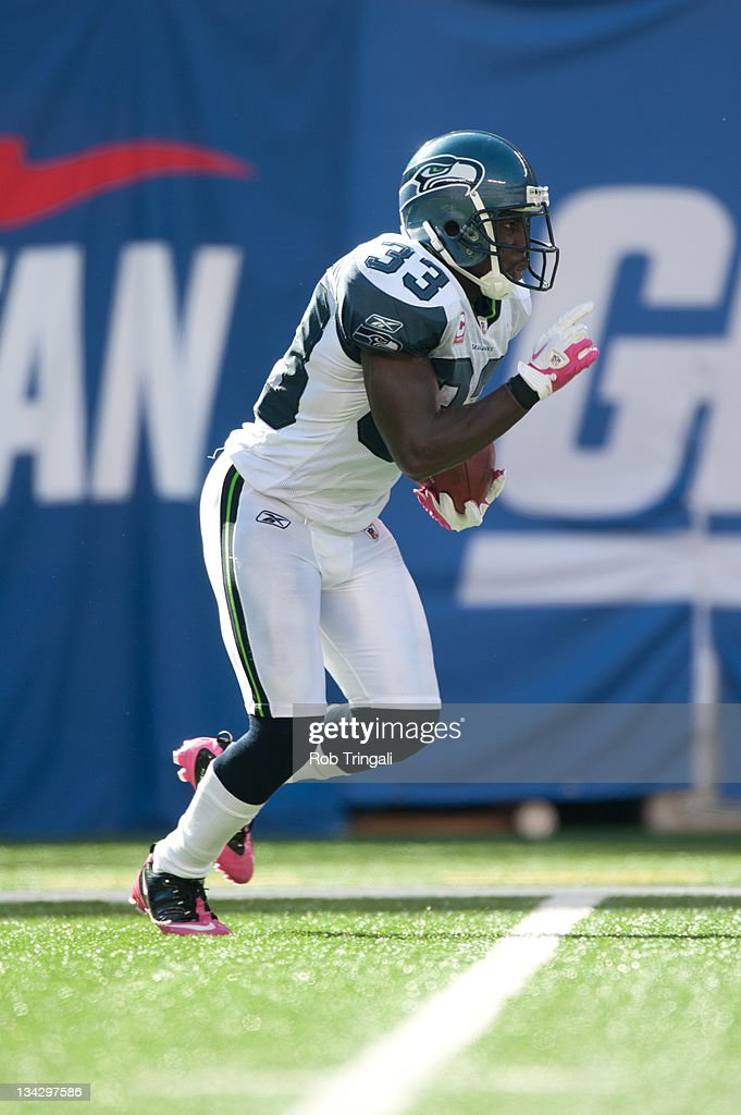 Leon Washington of the Seattle Seahawks runs the ball during the game against the New York Giants at MetLife Stadium on October 9 2011 in East...