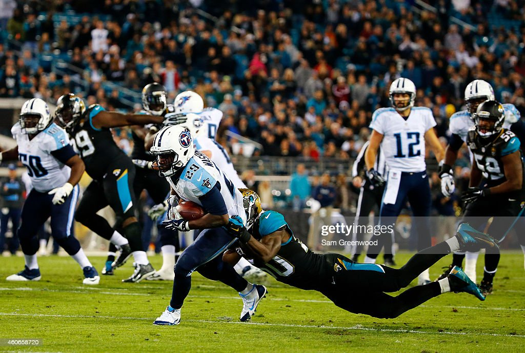 Leon Washington of the Tennessee Titans is tackled by Telvin Smith of the Jacksonville Jaguars in the fourth quarter at EverBank Field on December 18...