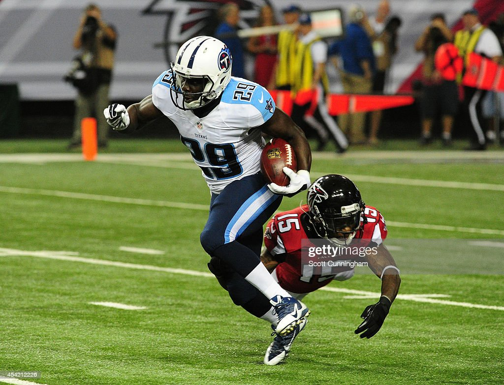 Leon Washington of the Tennessee Titans returns a kick in a preseason game against the Atlanta Falcons at the Georgia Dome on August 23 2014 in...