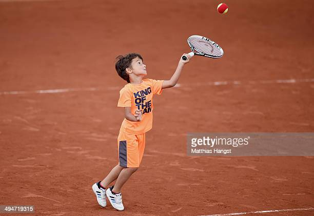 Leon Zimonjic the son of Nenad Zimonjic of Serbia plays tennis on court after his father's mixed doubles match on day six of the French Open at...