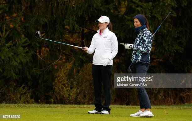 Leona Maguire and Sophie Lamb study the fourth hole during Curtis Cup practice at Quaker Ridge GC on November 22 2017 in Scarsdale New York