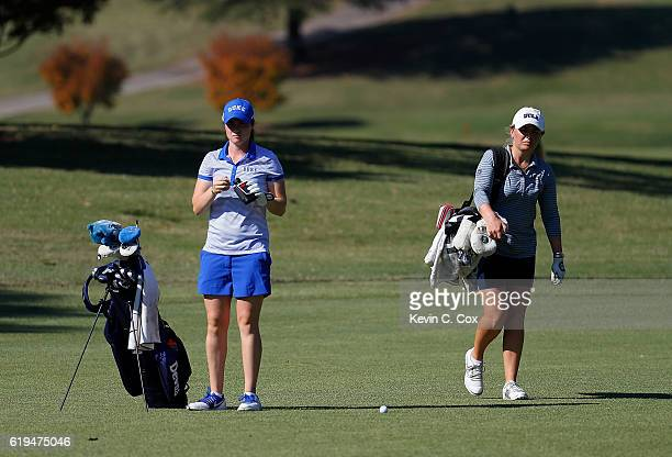 Leona Maguire of Duke prepares to play a shot on the first hole as Bronte Law of UCLA walks to the green during day 1 of the 2016 East Lake Cup at...