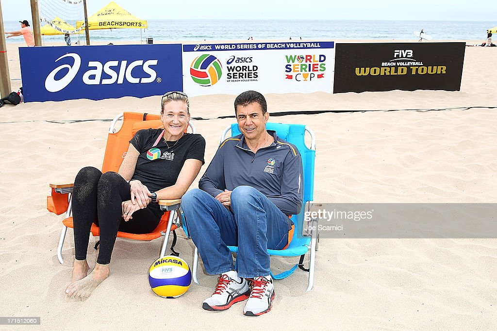 Leonard Armato, CEO and Three-time gold medalist <a gi-track='captionPersonalityLinkClicked' href=/galleries/search?phrase=Kerri+Walsh&family=editorial&specificpeople=162761 ng-click='$event.stopPropagation()'>Kerri Walsh</a> Jennings rpose for a photo at the ASICS World Series of Beach Volleyball on June 25, 2013 in Manhattan Beach, California