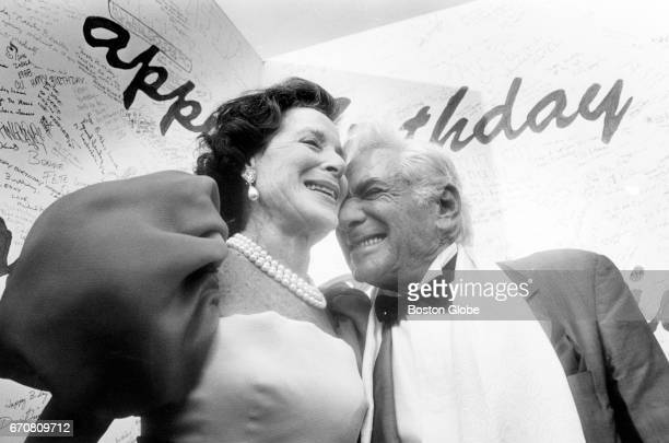 Leonard Bernstein right is given birthday happy wishes by Kitty Carlisle Hart during a preevent party at Tanglewood on Aug 25 1988