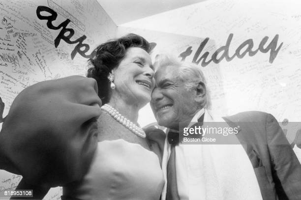 Leonard Bernstein right is given birthday wishes by Kitty Carlisle Hart left during a preevent party at Tanglewood Music Center in Lenox Mass Aug 25...