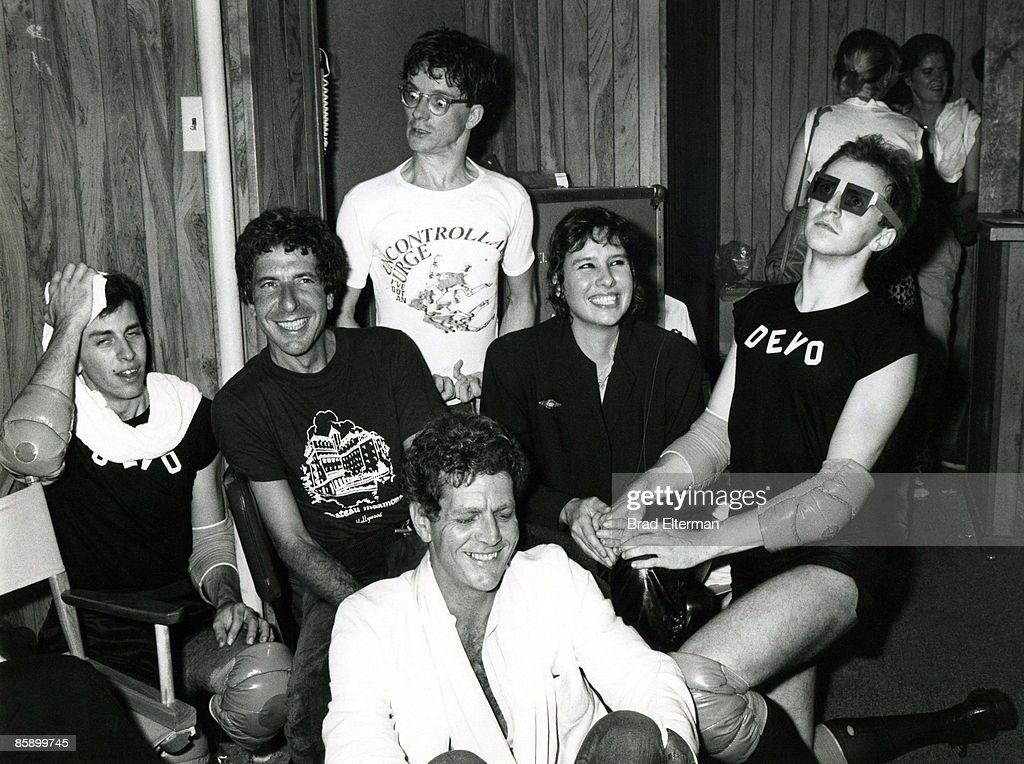 Leonard Cohen, David Blue ( seated ) Mark Mothersbaugh of Devo, Martine Getty and a Devo member backstage at The Starwood in Los Angeles, Calfornia. **EXCLUSIVE**