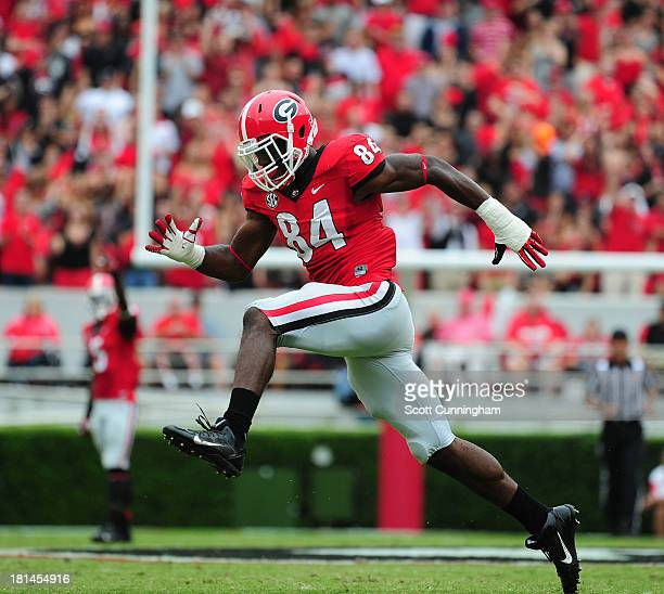 Leonard Floyd of the Georgia Bulldogs celebrates after making a tackle against the North Texas Mean Green at Sanford Stadium on September 21 2013 in...