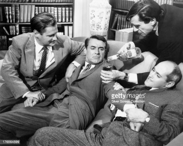 Leonard forces Roger O Thornhill to drink whisky as he is held by henchmen Valerian and Licht in a scene from 'North By Northwest' directed by Alfred...