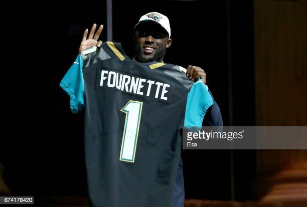 Leonard Fournette of LSU reacts poses after being picked overall by the Jacksonville Jaguars during the first round of the 2017 NFL Draft at the...