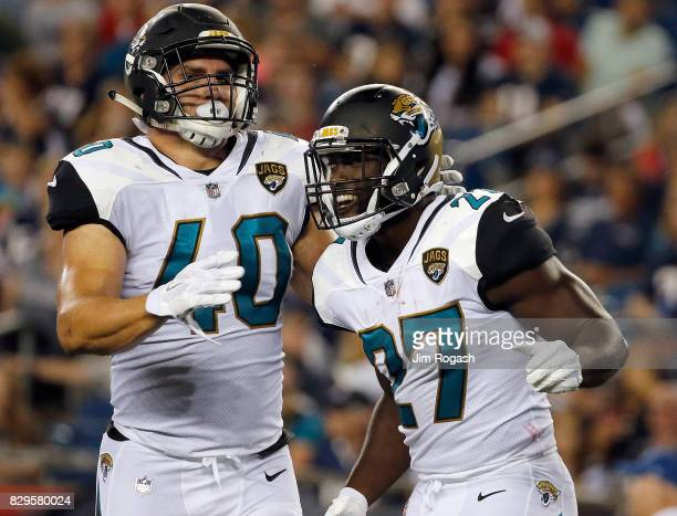 Leonard Fournette of the Jacksonville Jaguars celebrates his touchdown with Tommy Bohanon at the end of the second quarter against the New England...