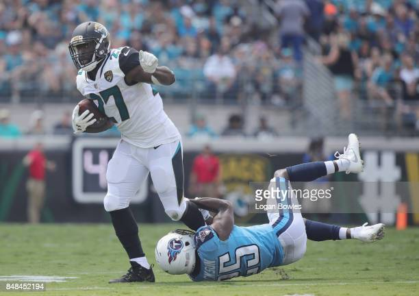 Leonard Fournette of the Jacksonville Jaguars is tackled by Adoree' Jackson of the Tennessee Titans during the first half of their game at EverBank...