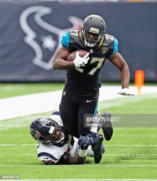 Leonard Fournette of the Jacksonville Jaguars is tackled by Benardrick McKinney at NRG Stadium on September 10 2017 in Houston Texas