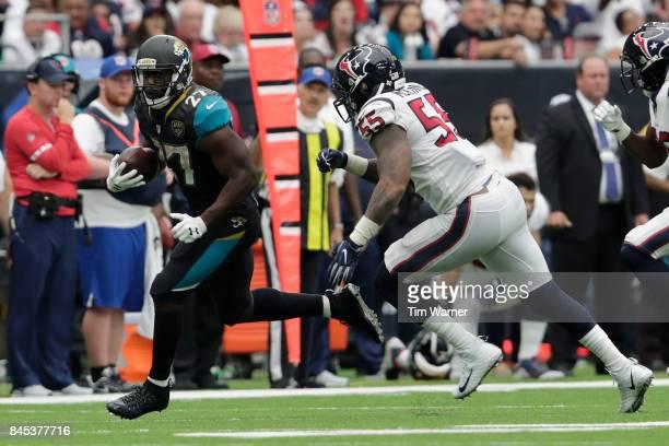 Leonard Fournette of the Jacksonville Jaguars runs the ball in the fourth quarter pursued by Benardrick McKinney of the Houston Texans at NRG Stadium...
