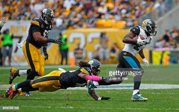 Leonard Fournette of the Jacksonville Jaguars rushes against Bud Dupree of the Pittsburgh Steelers in the second half during the game at Heinz Field...