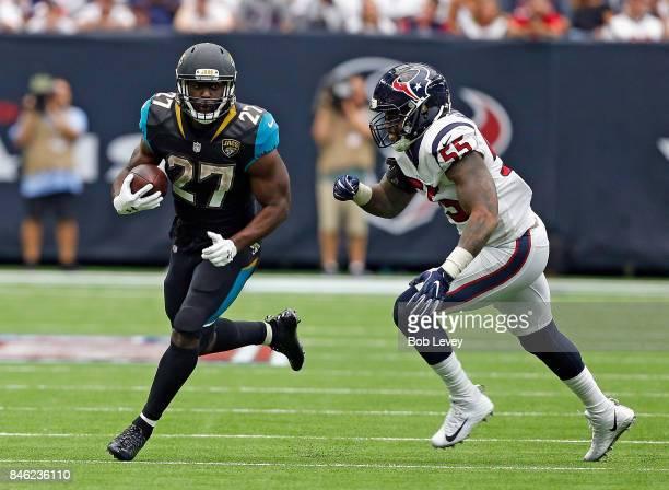 Leonard Fournette of the Jacksonville Jaguars rushes with the ball as Benardrick McKinney of the Houston Texans pursues at NRG Stadium on September...