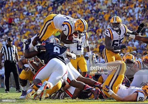 Leonard Fournette of the Louisiana State University Tigers leaps for a touchdown against the Auburn University Tigers at Tiger Stadium on September...