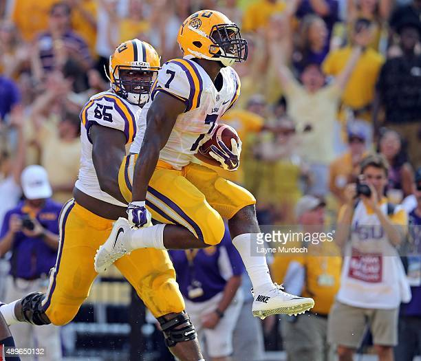 Leonard Fournette of the Louisiana State University Tigers runs for a touchdown against the Auburn University Tigers at Tiger Stadium on September 19...