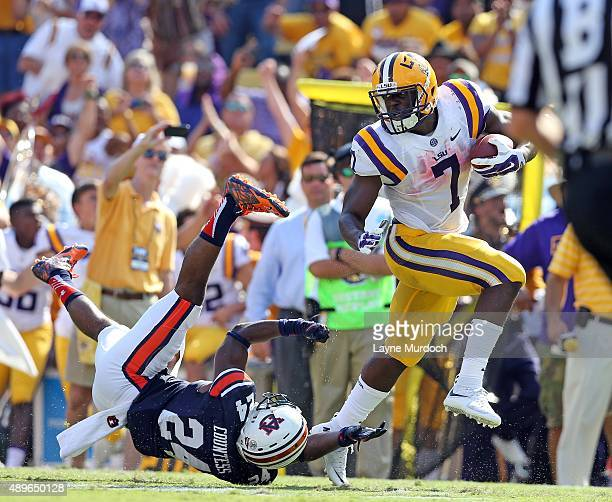 Leonard Fournette of the Louisiana State University Tigers runs against Blake Countess of the Auburn University Tigers at Tiger Stadium on September...