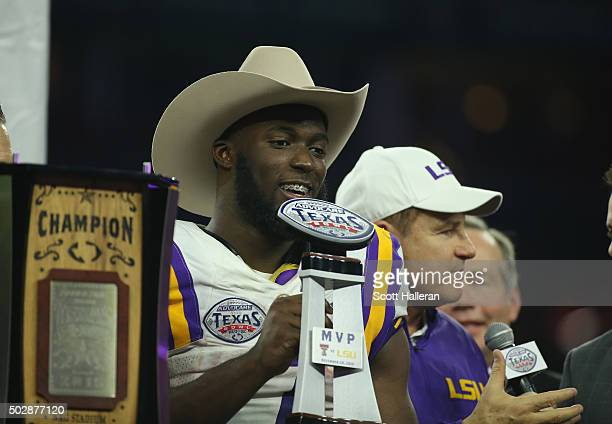 Leonard Fournette of the LSU Tigers and his head coach Les Miles pose on stage after the Tigers beat the Texas Tech Red Raiders 5627 during the...