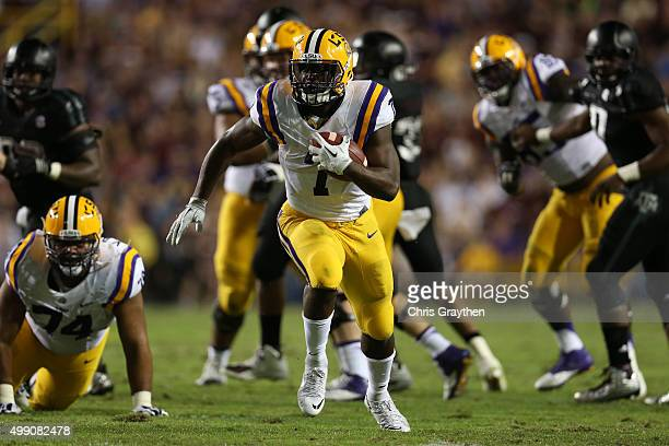 Leonard Fournette of the LSU Tigers breaks a tackle against the Texas AM Aggies at Tiger Stadium on November 28 2015 in Baton Rouge Louisiana