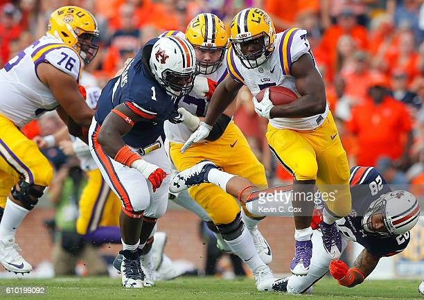 Leonard Fournette of the LSU Tigers breaks a tackle as he rushes away from Tray Matthews of the Auburn Tigers at JordanHare Stadium on September 24...