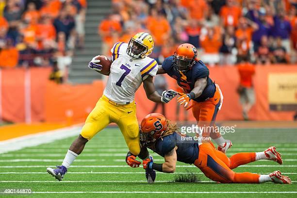 Leonard Fournette of the LSU Tigers breaks a tackled during the first half against the Syracuse Orange on September 26 2015 at The Carrier Dome in...