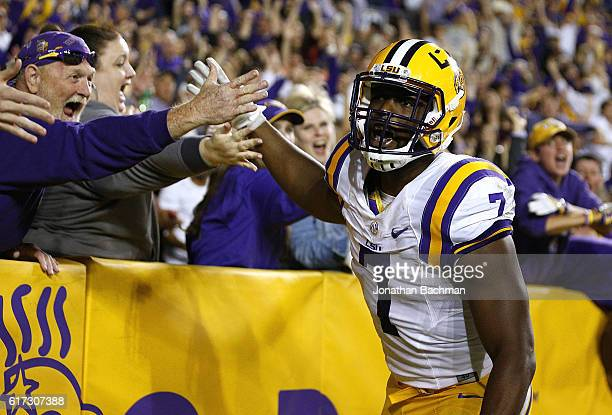 Leonard Fournette of the LSU Tigers celebrates a 76yard touchdown during the first half of a game against the Mississippi Rebels at Tiger Stadium on...