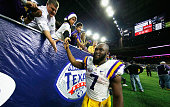 Leonard Fournette of the LSU Tigers greets fans after the Tigers defeated the Texas Tech Red Raiders 5627 during the AdvoCare V100 Texas Bowl at NRG...